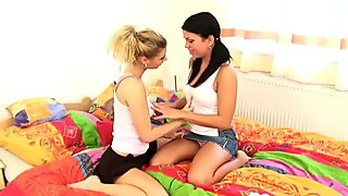 Hot lesbian babes enjoy drilling each other's cunts